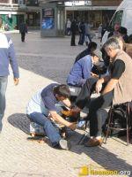 Das Schuhputzen auf den Straßen Lissabons hat Tradition